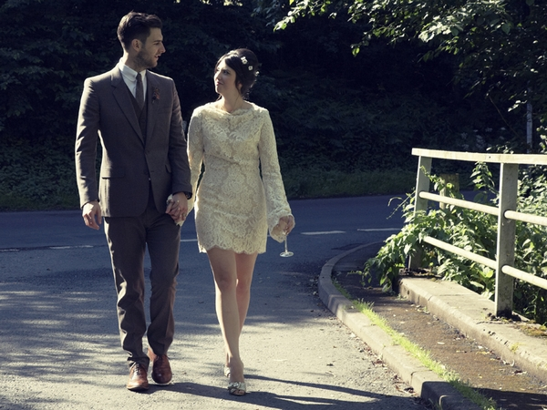 Bride and groom walking holding hands - Picture by Ian Shoots Weddings