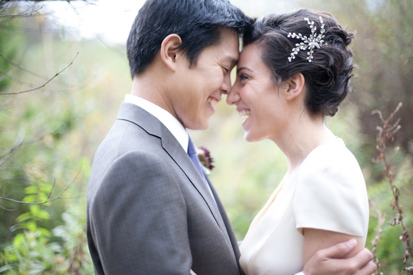 Bride and groom touching foreheads - Picture by Levi Stolove Photography