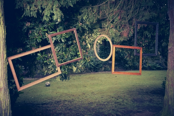 Picture frames hanging from trees - Picture by Ian Shoots Weddings