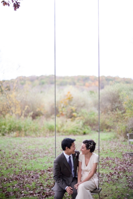 Bride and groom stitting on swing - Picture by Levi Stolove Photography