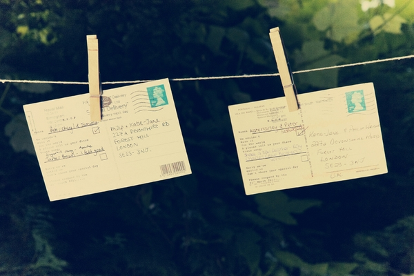 Postcards pegged to clothes line - Picture by Ian Shoots Weddings