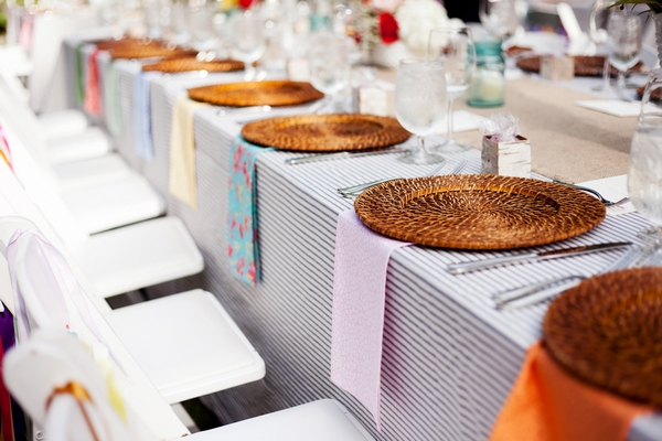 Wedding breakfast table with wicker table chargers - Picture by Laura Ivanova Photography
