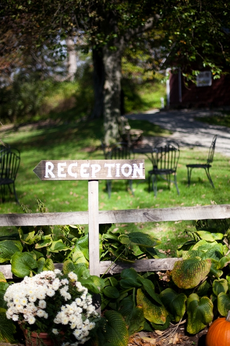 Wooden 'Reception' sign - Picture by Levi Stolove Photography