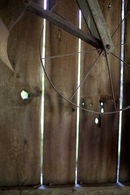 Wheel hanging in barn - Picture by Levi Stolove Photography