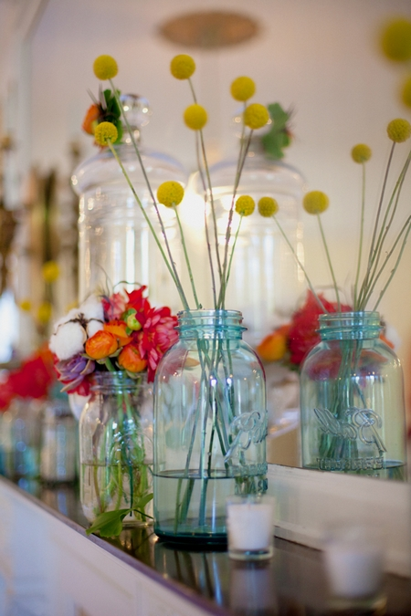 Jars of wedding flowers on shelf - Picture by Rojo Foto Design