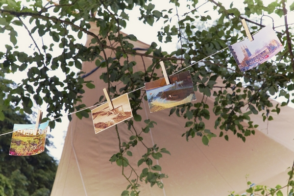Postcards hanging on clothes line - Picture by Ian Shoots Weddings