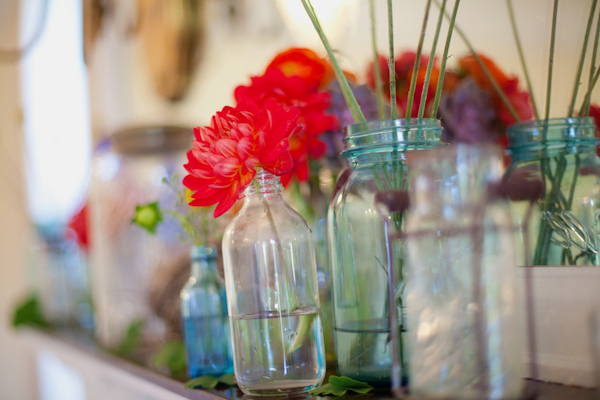 Jars and bottles of wedding flowers - Picture by Rojo Foto Design