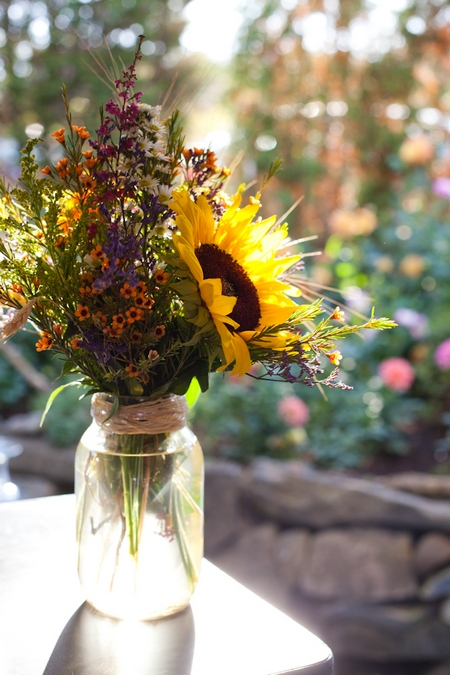Jar of wedding flowers - Picture by Levi Stolove Photography