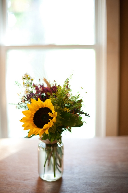 Jar of flowers with sunflower - Picture by Levi Stolove Photography