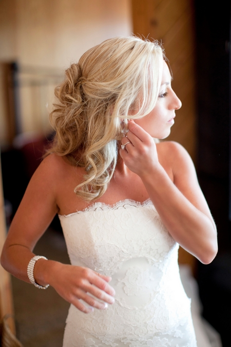 Bride putting on earring - Picture by Laura Ivanova Photography