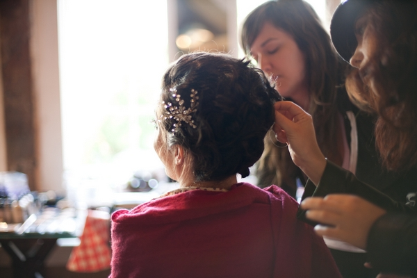 Bride having her hair done for her wedding - Picture by Levi Stolove Photography