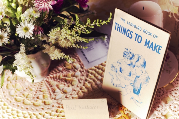 Vintage wedding props on table - Picture by Ian Shoots Weddings