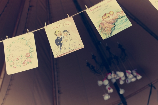Vintage cards hanging from clothes line - Picture by Ian Shoots Weddings