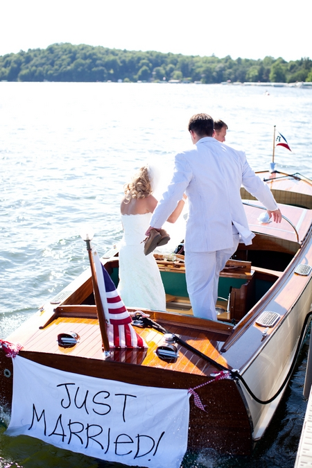Bride and groom getting into boat - Picture by Laura Ivanova Photography
