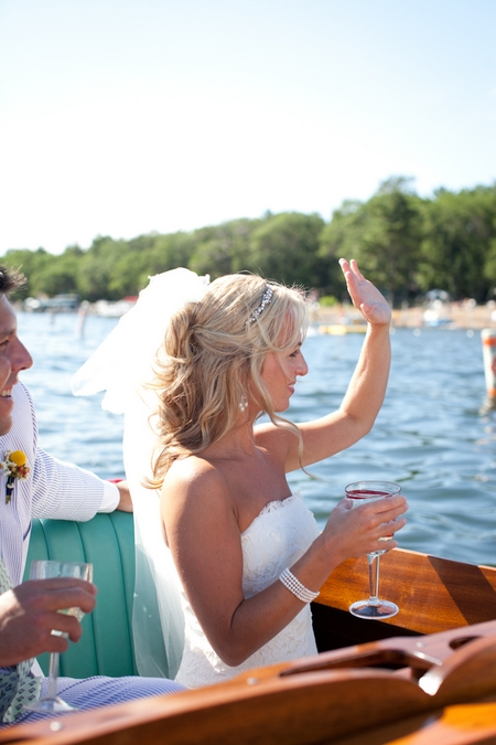 Bride waving from boat - Picture by Laura Ivanova Photography