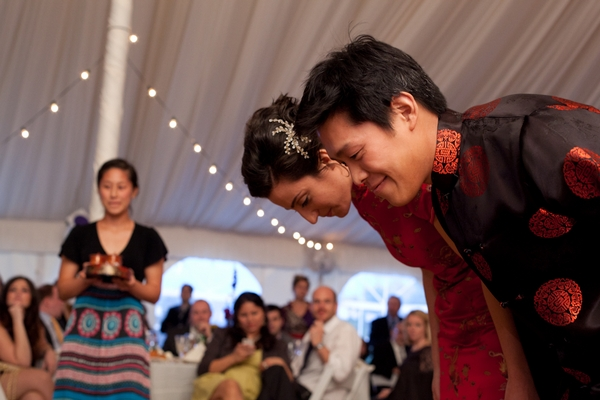 Bride and groom bowing at Chinese tea ceremony - Picture by Levi Stolove Photography