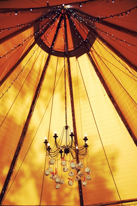 Chandelier hanging inside tipi - Picture by Ian Shoots Weddings