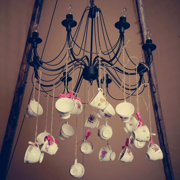 Teacups hanging from chandelier - Picture by Ian Shoots Weddings