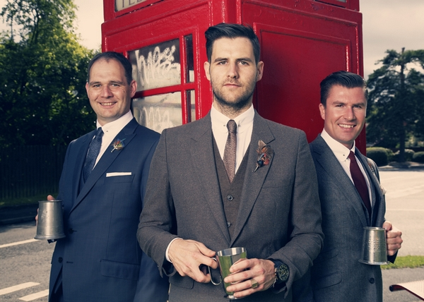 Groomsmen standing in front of a red phone box - Picture by Ian Shoots Weddings