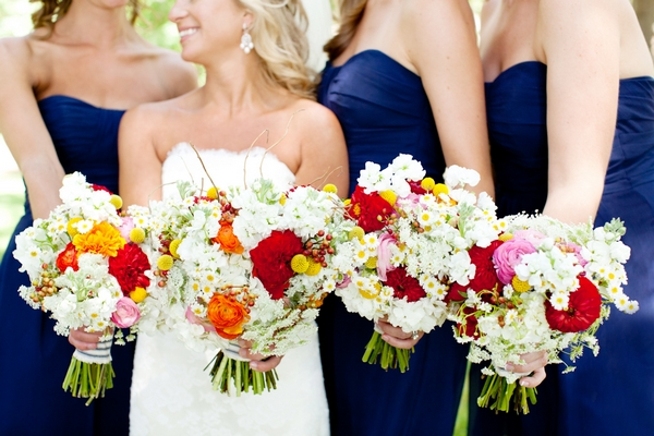 Bride and bridesmaids holding bouquets - Picture by Laura Ivanova Photography