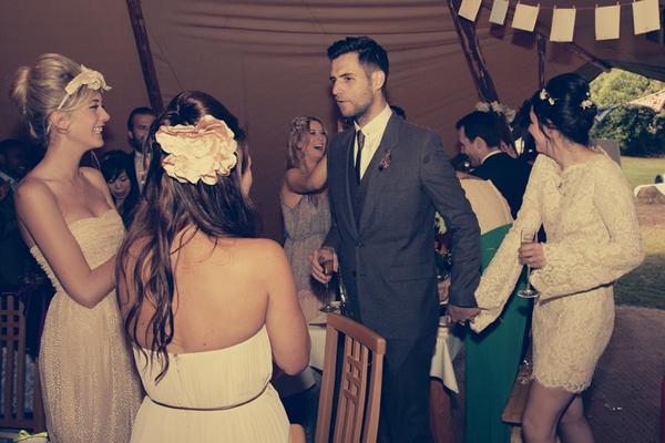 Bride and groom entering tipi wedding reception