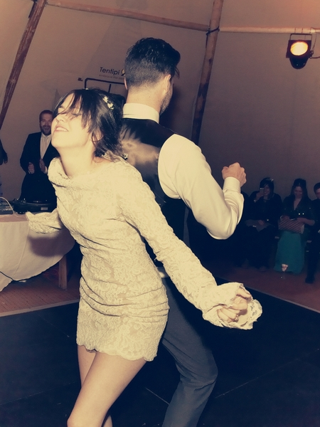 Bride and groom dancing back to back - Picture by Ian Shoots Weddings