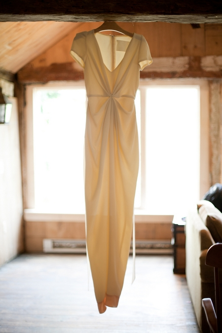 Wedding dress hanging from a beam - Picture by Levi Stolove Photography