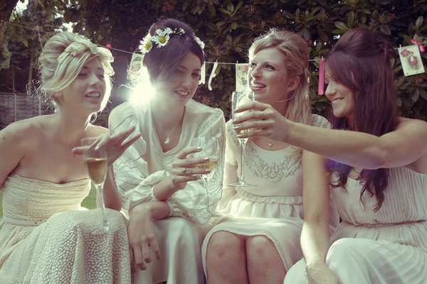 Bridesmaids sitting together - Picture by Ian Shoots Weddings