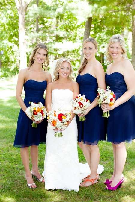 Bride with bridesmaids wearing blue dresses - Picture by Laura Ivanova Photography