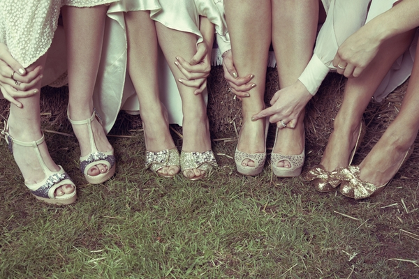 Bride and bridesmaids legs showing their bridal shoes - Picture by Ian Shoots Weddings