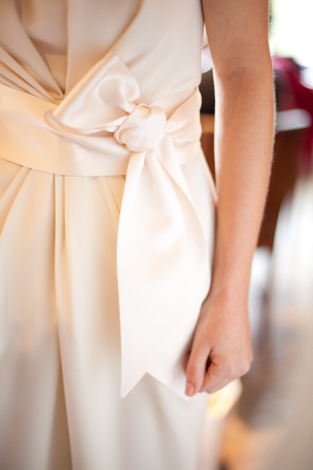 Bow on bride's wedding dress - Picture by Levi Stolove Photography