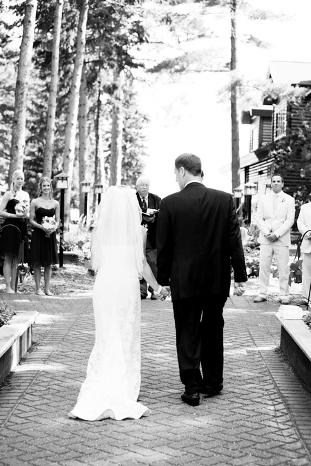 Father walking daughter down the aisle - Picture by Laura Ivanova Photography