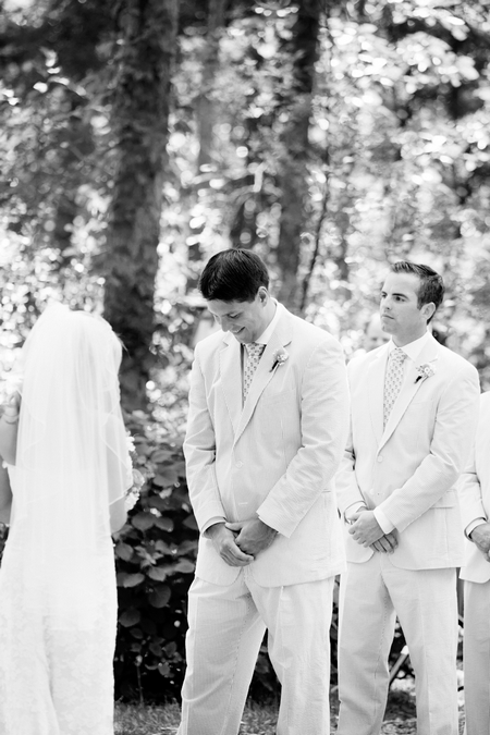Groom looking down at wedding ceremony - Picture by Laura Ivanova Photography