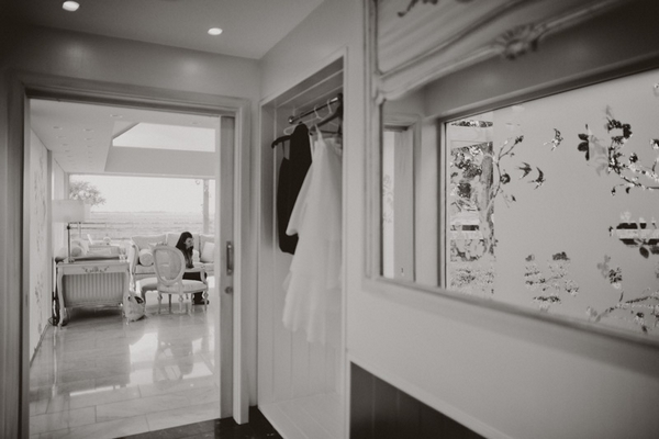 Hallway with wedding dress hanging up - Picture by Jonas Peterson Photography