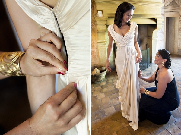 Bride having wedding dress adjusted - Picture by Gill Maheu Photography