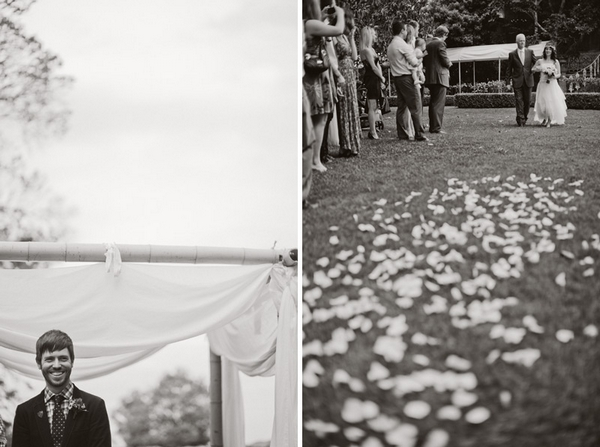 Bride walking down aisle with petals on grass - Picture by Jonas Peterson Photography