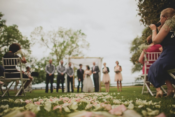Petals on grass of wedding ceremony - Picture by Jonas Peterson Photography