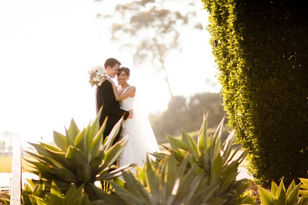 Bride with arms around groom - Picture by Allyson Magda Photography