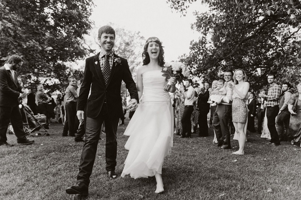 Happy bride and groom walking out of wedding ceremony - Picture by Jonas Peterson Photography
