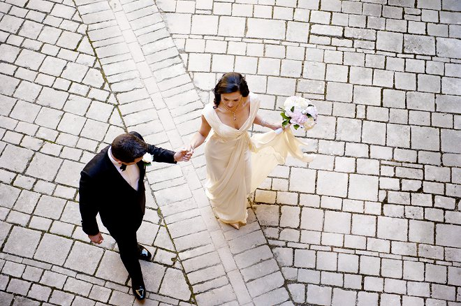 Bride and groom holding hands walking to wedding - Picture by Gill Maheu Photography