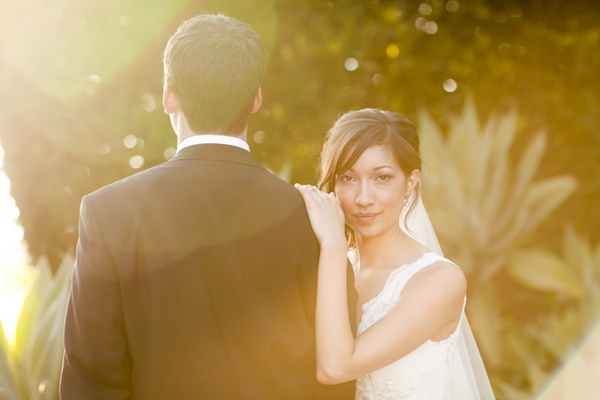 Bride with hand on groom's shoulder - Picture by Allyson Magda Photography