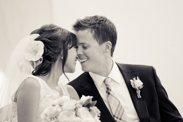 Bride and groom touching noses - Picture by Allyson Magda Photography