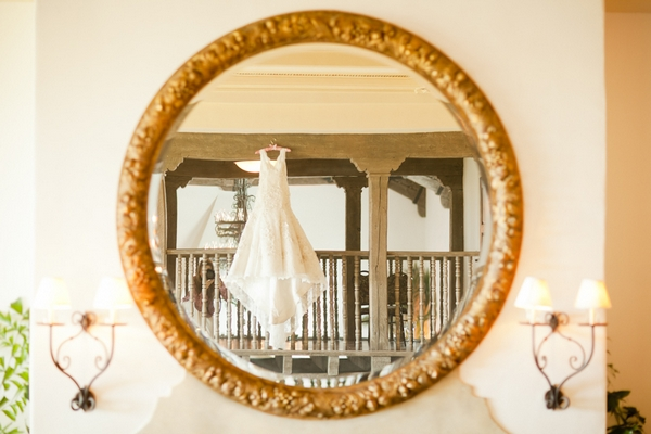 Wedding dress in mirror - Picture by Allyson Magda Photography