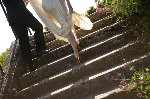 Legs of bride and groom as they walk up steps - Picture by Gill Maheu Photography