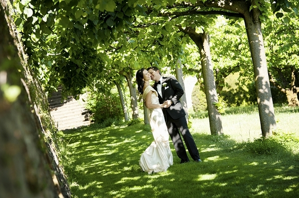 Bride and groom surrounded by trees - Picture by Gill Maheu Photography
