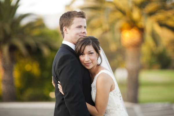 Bride hugging groom - Picture by Allyson Magda Photography