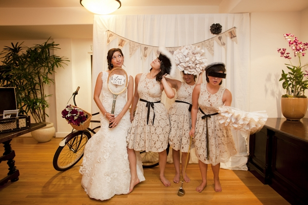 Bride and bridesmaids posing with props - Picture by Allyson Magda Photography