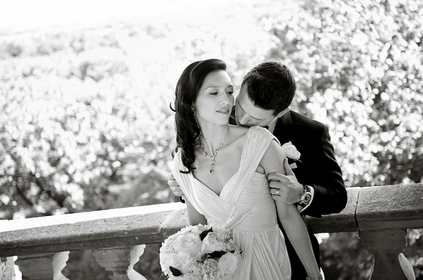 Groom kissing brides neck - Picture by Gill Maheu Photography