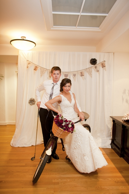 Bride and groom sitting on push bike - Picture by Allyson Magda Photography