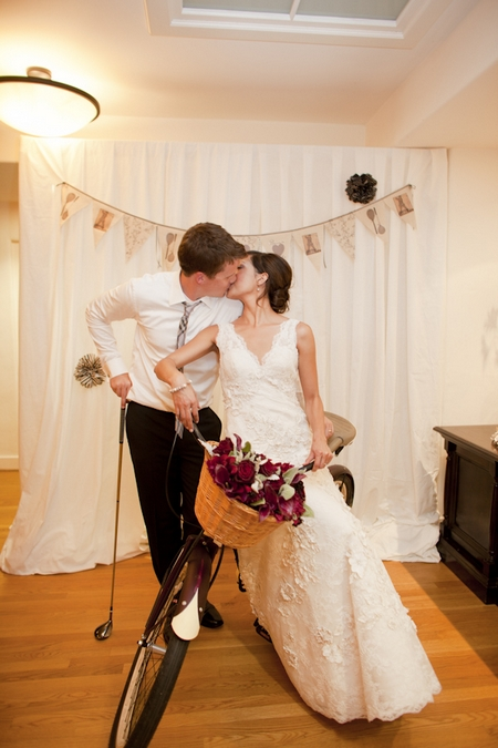 Bride and groom kissing on push bike - Picture by Allyson Magda Photography
